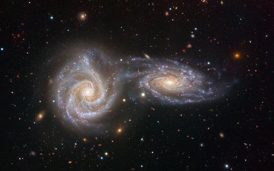 有一些小型大班运转着银河系围绕,甚至有时与银河系碰撞合并.范文测量课说课稿星系图片