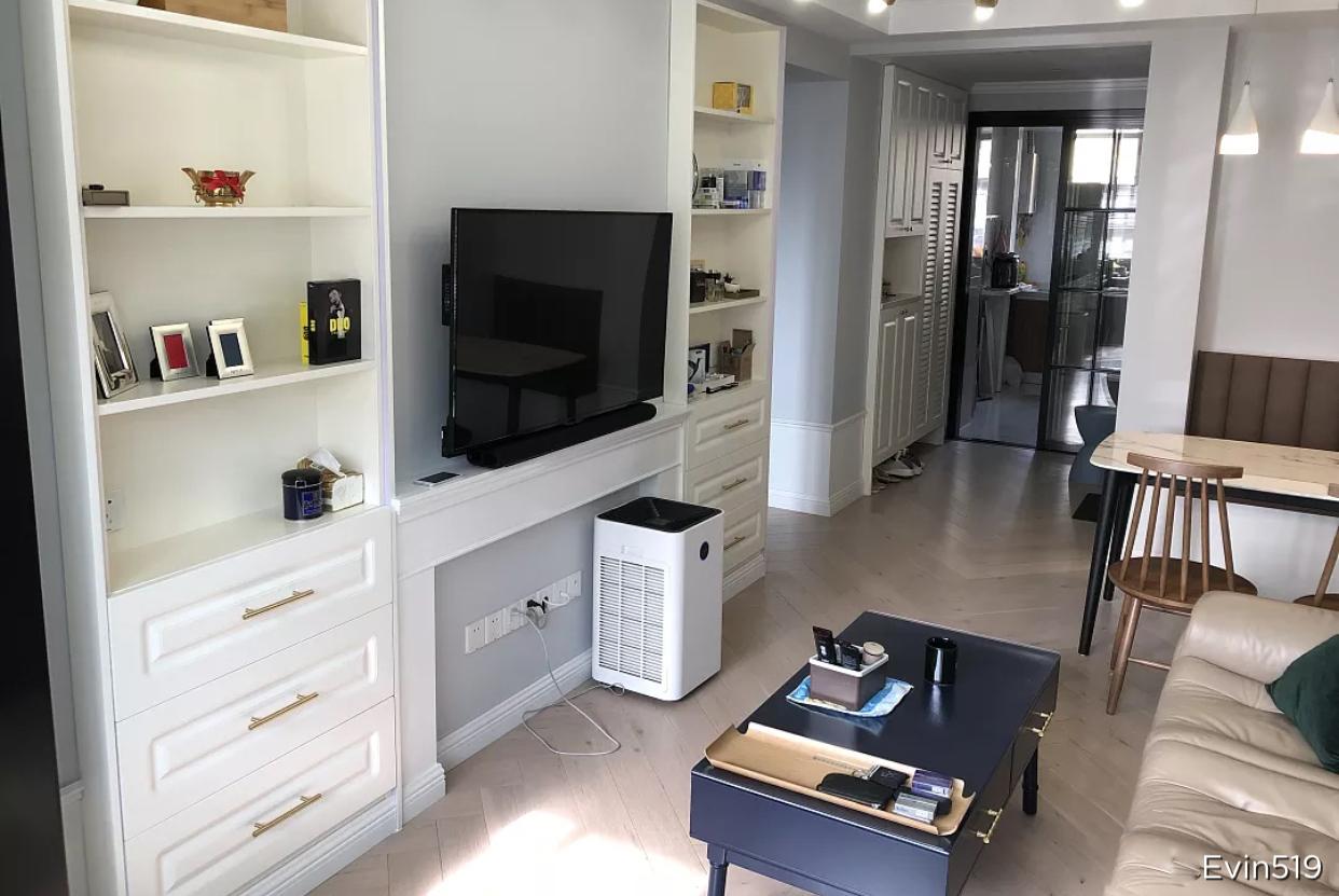 他在上海63平的房子,装修花了20W,电视墙这样设计第一次见!