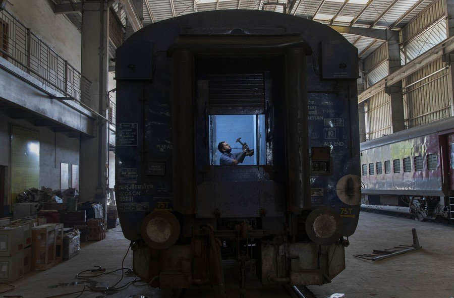 An Indian railway employee works to convert a train coach into an isolation ward for the fight against the new coronavirus in Gauhati, on March 29, 2020.