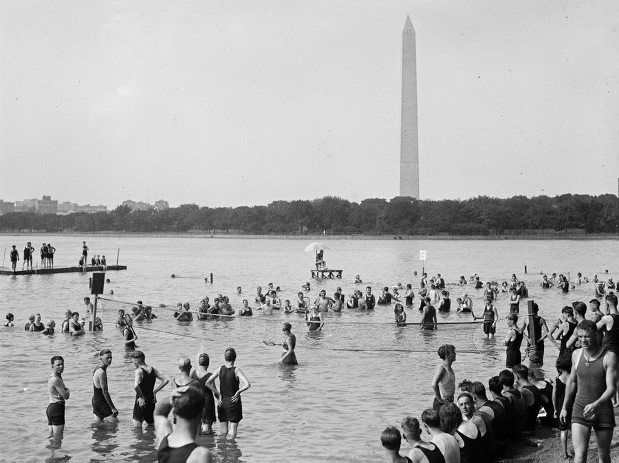 People play a game of water tennis, in Washington, D.C., in August of 1921.