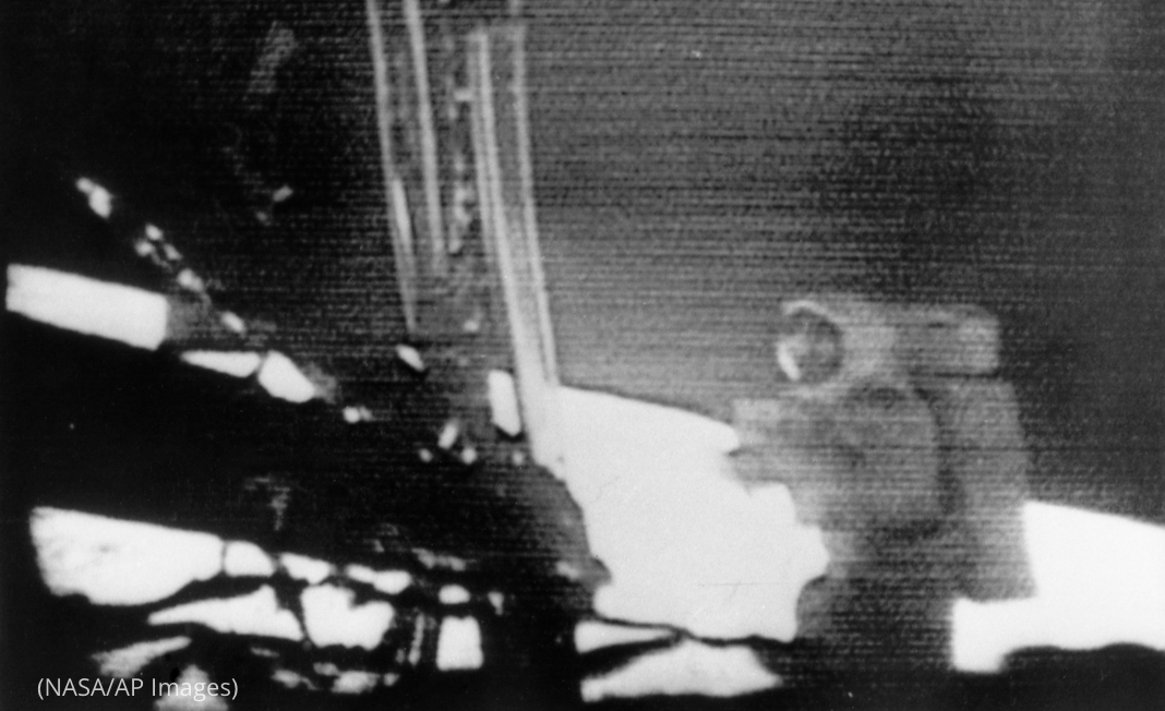 Blurry image of Neil Armstrong walking on surface of moon (NASA/AP Images)