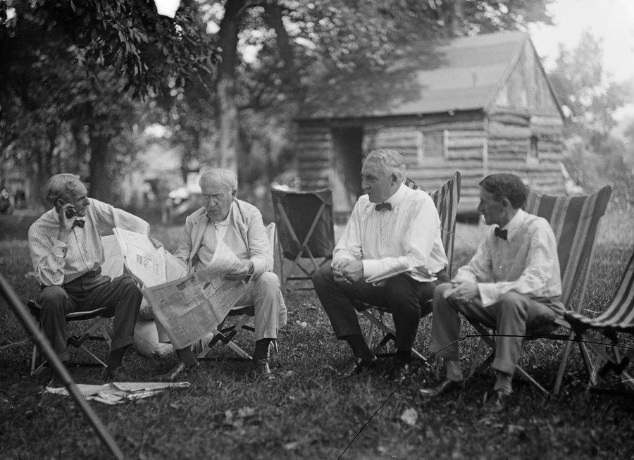 Henry Ford, Thomas Edison, President Warren Harding, and Harvey Firestone spend time together during a camping trip in Washington County, Maryland, in July of 1921.