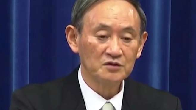 日本首相菅义伟会见王毅